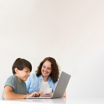 Mother with child working on laptop
