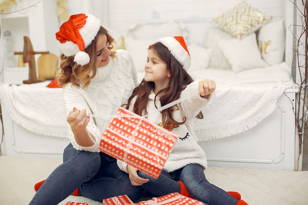 Mother with cute daughter in a christmas decorations