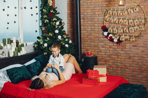 Mother with cute son celebrating christmas