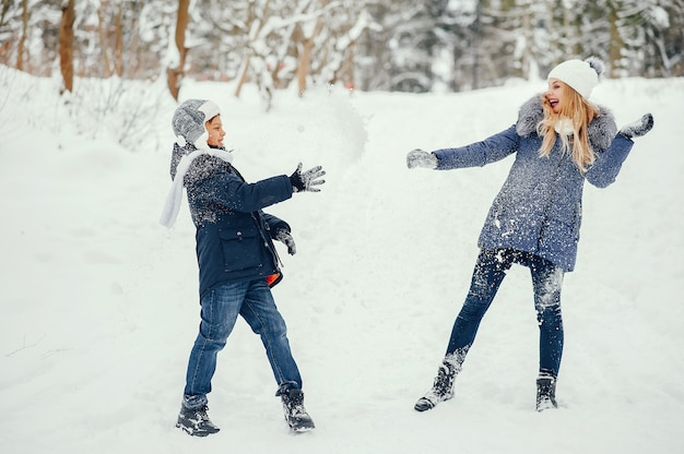 Mother with cute son in a winter oark