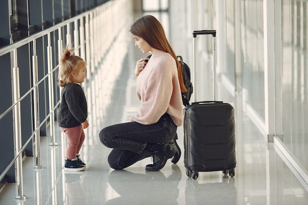 Mother with daughter at the airport