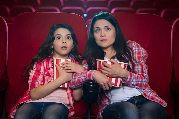 Mother with daughter in cinema