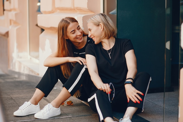 Mother with daughter in a city