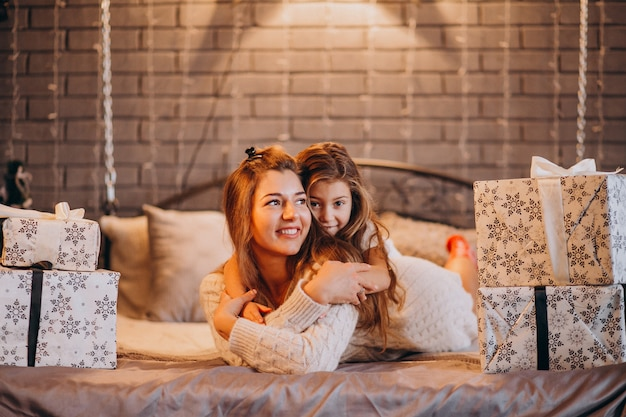 Mother with daughter lying in bed on christmas