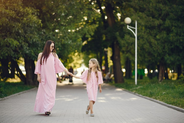 Mother with daughter playing in a summer park