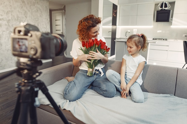 Mother with daughter shoots a blog at home