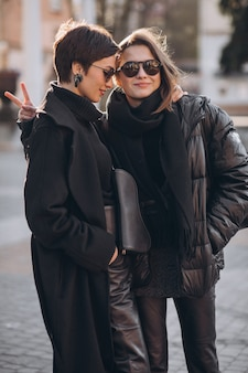 Mother with daughter together at the street