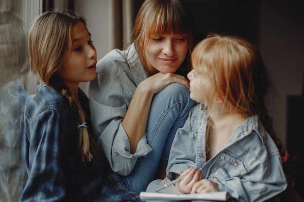 Mother with daughters at home