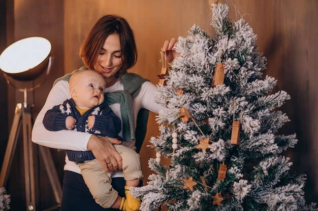 Mother with her baby boy celebrating christmas