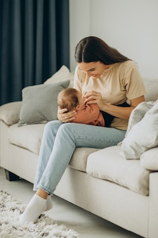 Mother with her baby girl at home