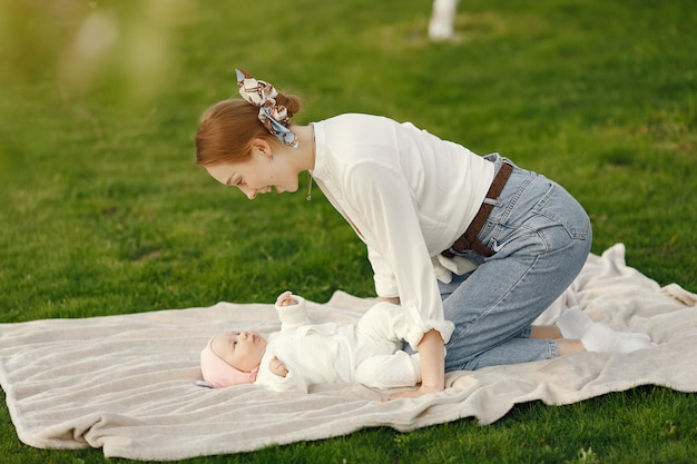 Mother with her baby spend time in a summer garden