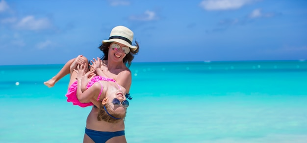 Mother with her cute daughter have fun on summer vacation