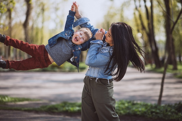 Mother with her little son having fun in park
