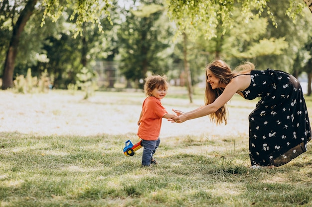 Mother with her little son together in park