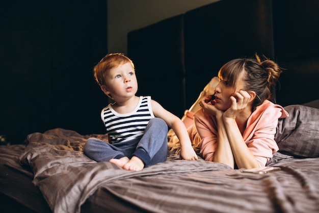 Mother with her son in bed