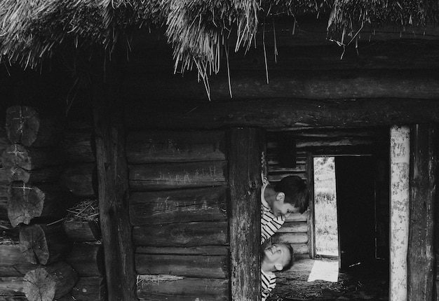 Mother with her son old wooden house, lifestyle