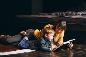 Mother with her son playing reading book