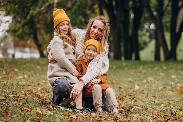 Mother with kids having fun in park