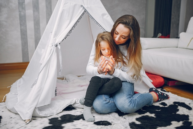 Mother with little daughter at home