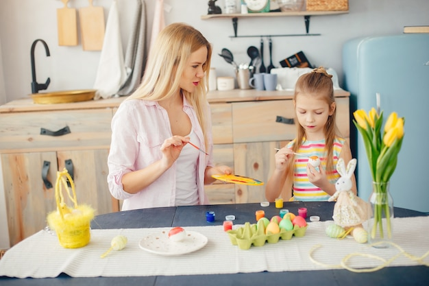 Mother with little daughter in a kitchen