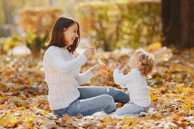 Mother with little daughter playing with a bubbles