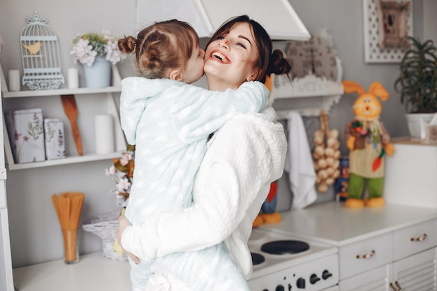 Mother with little daughter in a room