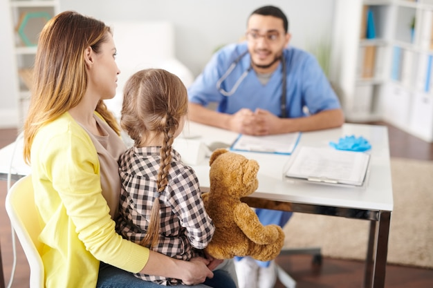 Mother with little girl in doctor's office