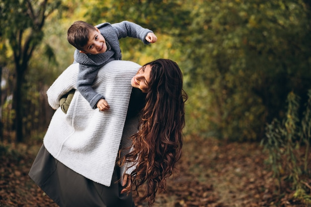 Mother with little son in an autumn park