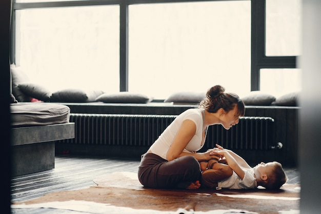 Mother with little son doing yoga at home