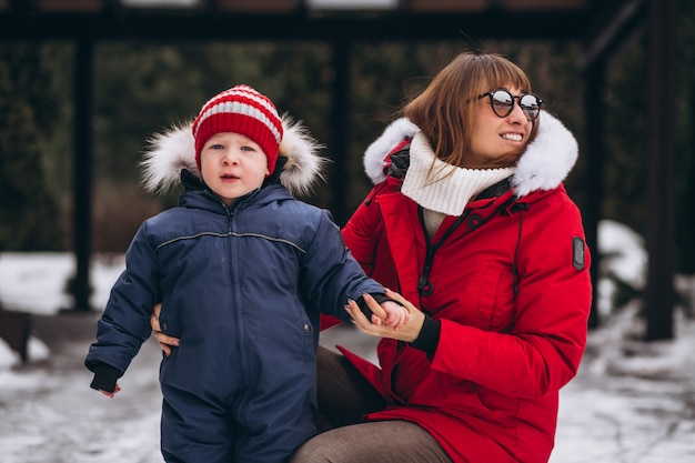 Mother with little son outside in winter