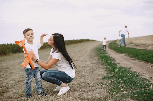 Mother with little son playing with toy plane
