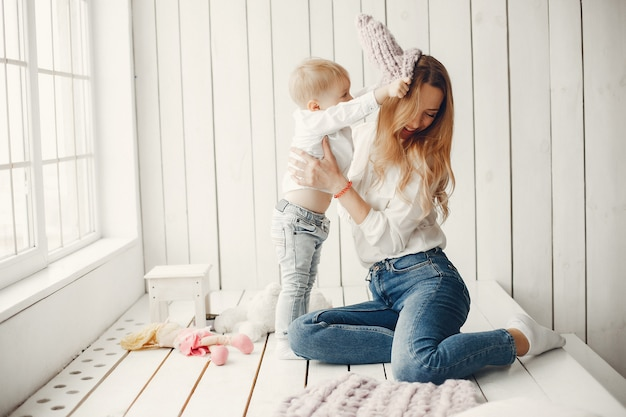 Mother with little son in a room