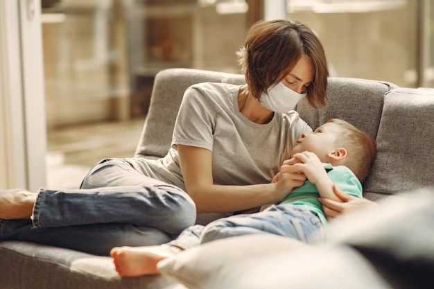 Mother with littler son sitting at home on quarantine