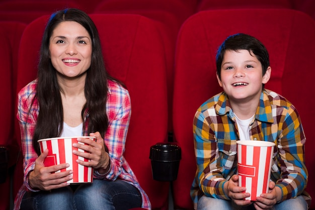 Mother with son in cinema
