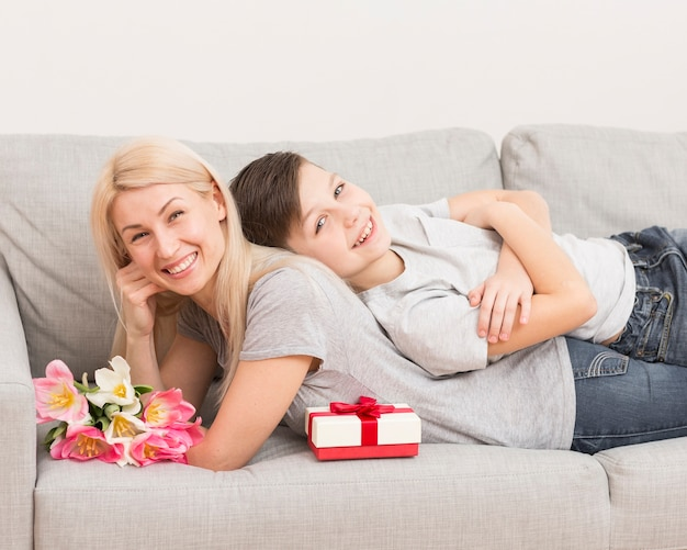 Mother with son on couch