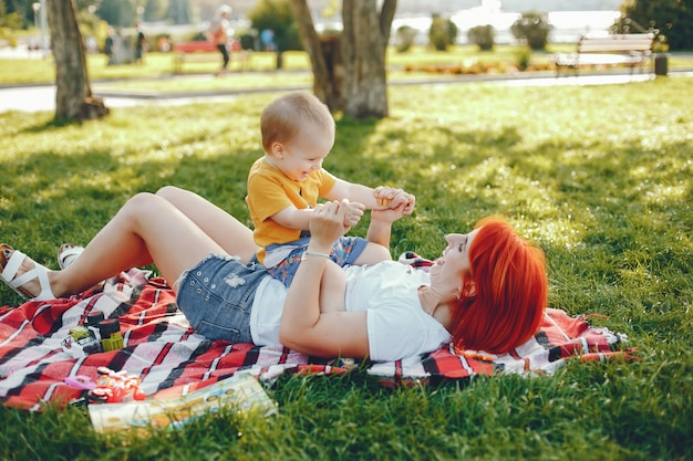 Mother with son playing in a summer park