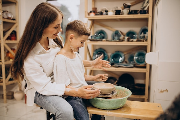 Mother with son at a pottery class