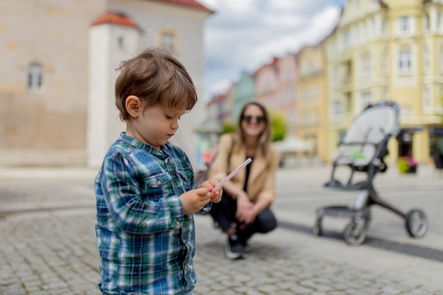 Mother with a toddler boy in old city center