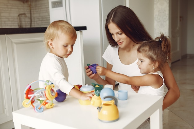 Mother with two children playing in a bathroom