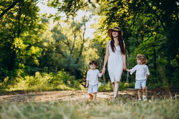 Mother with two sons in park having fun