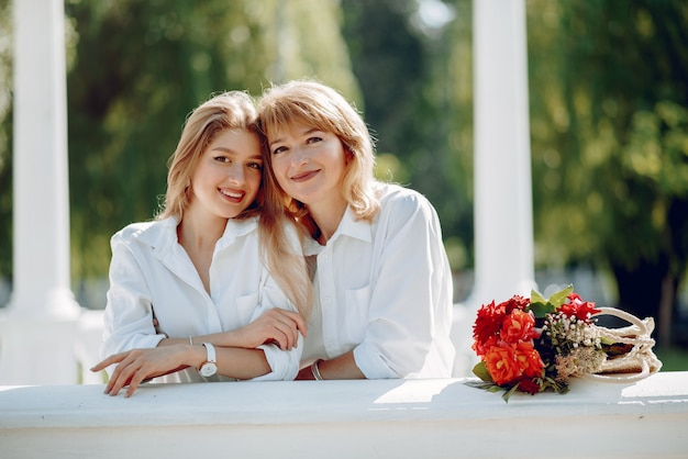 Mother with young daughter in a summer park