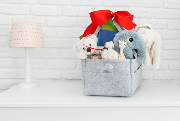 Mothers bag with toy, diapers and accessories on white