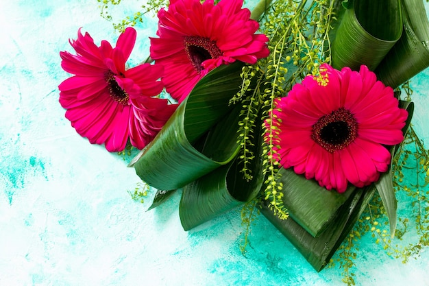 Mothers day background or greeting card bouquet red flowers of gerbera copy space