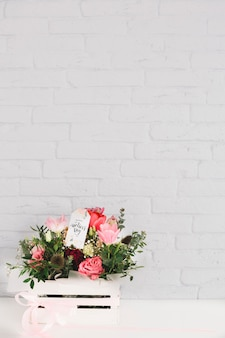 Mothers day background with flowers in a box