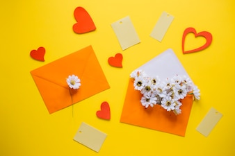 Mothers day composition with orange envelopes