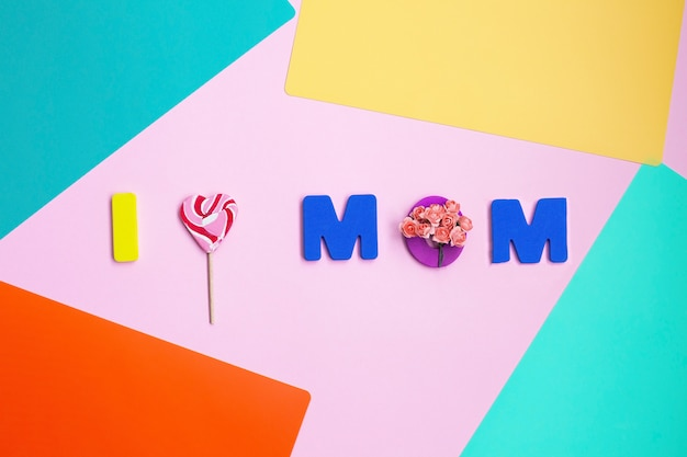 Mothers day message on color background. top view