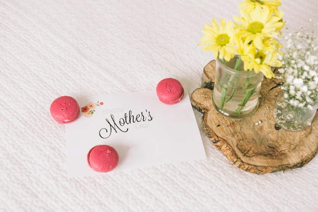Mothers inscription with flowers and macaroons