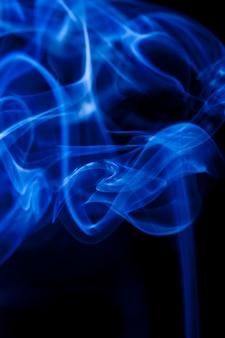 Motion blue smoke on black background.