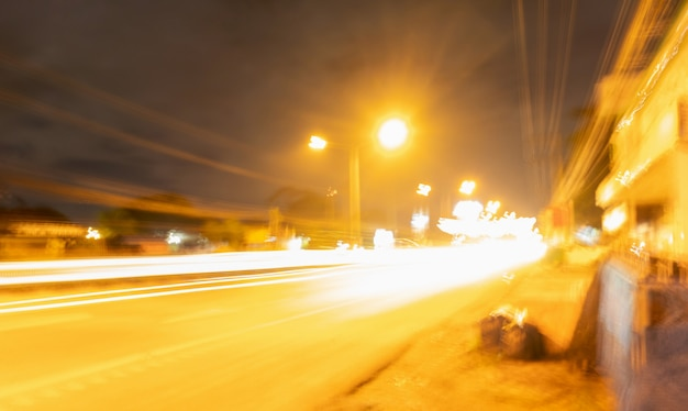Motion blur of the golden lights on the streets at night, concept visually represents big data.