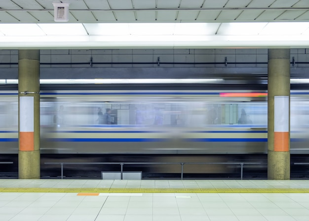 Motion blur side of high speed train in subway